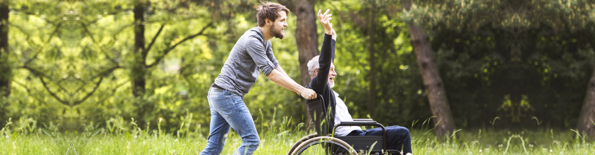 caregiver and his patient on a wheelchair having a good time